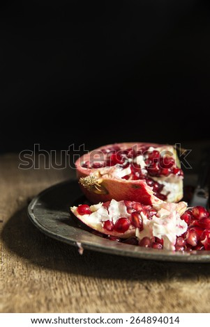 Moody natural lighting images of fresh juicy pomegranate with vintage style