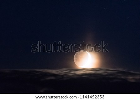 Moon above clouds #1141452353