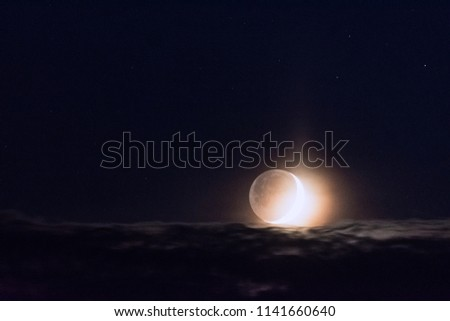 Moon above clouds #1141660640