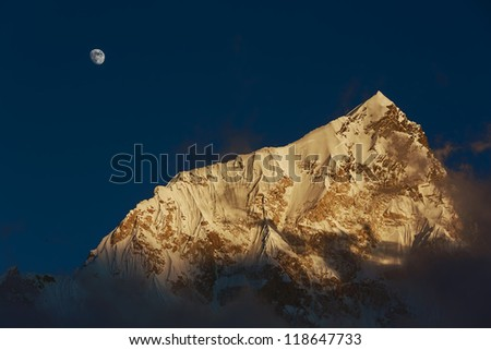 Moon and Nuptse (7864 m) at sunset (view from Kala Patthar) - Everest region, Nepal, Himalayas