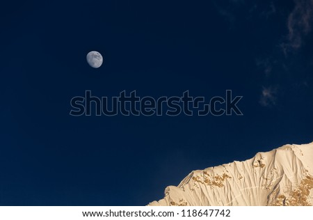 Moon and slope of the Nuptse (7864 m) at sunset (view from Kala Patthar) - Everest region, Nepal, Himalayas