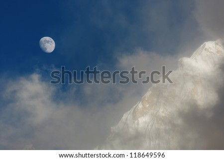 Moon and slope of the Nuptse (7864 m) at sunset (view from Kala Patthar) - Everest region, Nepal