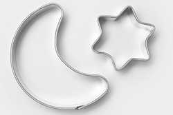 Moon and star-shaped cookie cutters for Christmas cookies