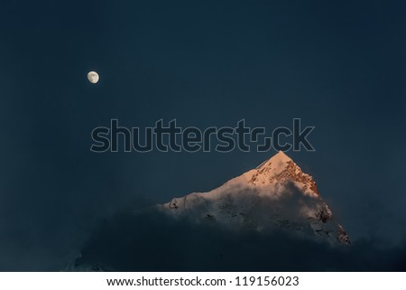 Moon and top of the Nuptse (7864 m) at sunset (view from Kala Patthar) - Everest region, Nepal