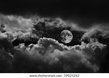 Moon between the clouds in black and white