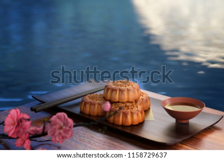 Moon cake on the red background,Asian traditional festival, Mid-Autumn festival.Chinese traditional festival.3d rendering.