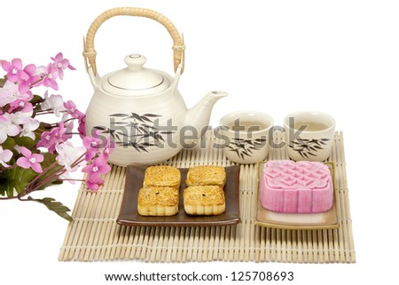 Moon cake two size with tea isolated
