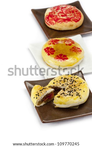 Moon cake with sesame topping and yolk inside