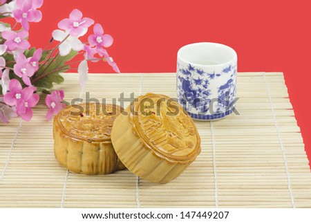 Moon cakes ,traditional chinese bakery on red background.