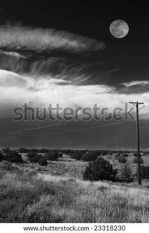 Moon, clouds and power lines. Black and White.