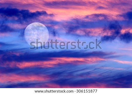 Moon clouds skies is a vibrant surreal fantasy like cloudscape with the ethereal heavenly full moon rising among the vibrant cloudscape.