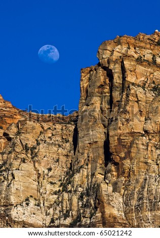 Moon coming up over a Rocky Cliff in Zions