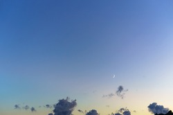 moon in a clear sky at night, crescent in the sky