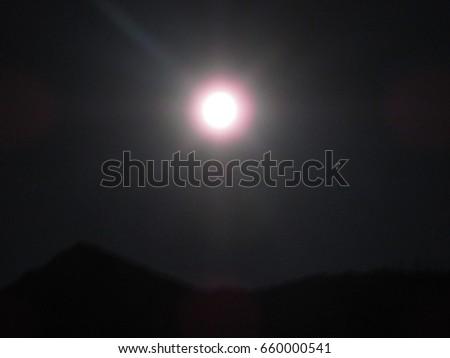 Moon in dark black sky at night #660000541