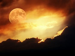 Moon in dark clouds