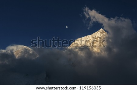 Moon Moon over Mount Everest (the highest peak in the world 8848 m) and Nuptse (7864 m) at sunset (view from Kala Patthar) - Everest region, Nepal
