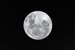 Moon on little stars background in the dark night.