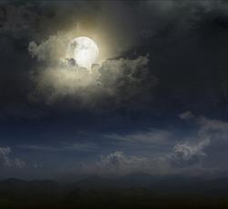 Moon over mountain peaks