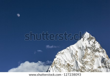 Moon over Nuptse (7864 m) at sunset (view from Kala Patthar) - Everest region, Nepal, Himalayas