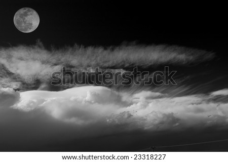Moon over the clouds. Black and White.