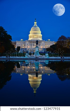 Moon over United States Capitol building in Washington DC, USA