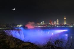 Moon over violet lit Niagara Falls