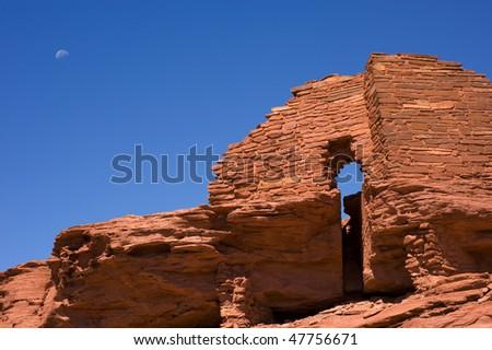 Moon over Wukoki pueblo in Wuptki National monument, Arizona - stock photo