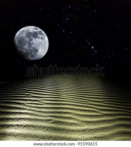 moon rise above a sand desert - stock photo
