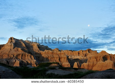 Moon rises over the mountains at Badlands