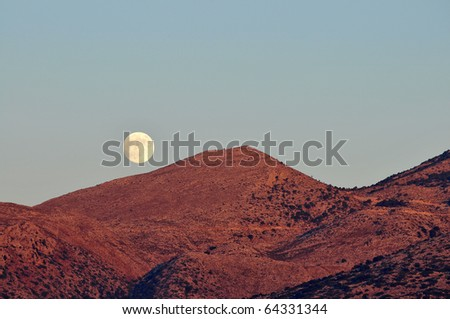 Moon rises over the mountains at Crete,Greece