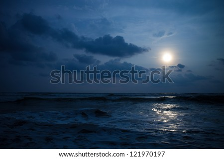 Moon under ocean - stock photo