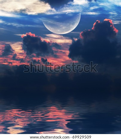 moon with  clouds over the water