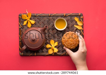 Mooncake and tea,food and drink for Chinese mid autumn festival. angle view from above