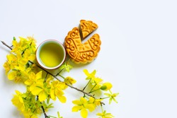 Mooncake and tea, food and drink for Chinese mid autumn festival. Isolated on white background