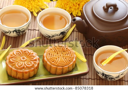 mooncake and tea for Chinese mid autumn festival - stock photo