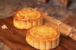 Mooncakes on wooden floors Chinese mid autumn festival foods Chinese mid autumn festival foods. With text