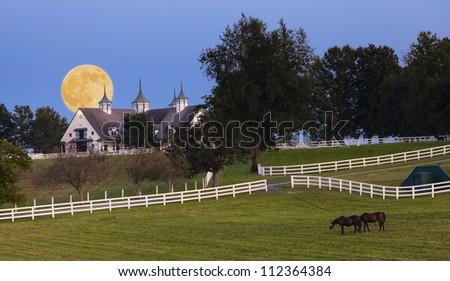 Moonrise over horse farm