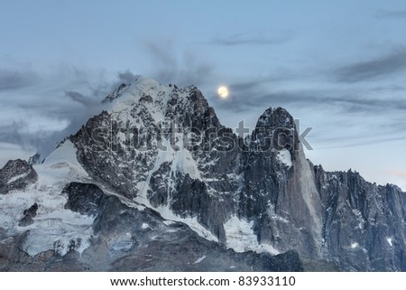 Moonrise over the Aiguille Verte (4122m) in Mont Blanc Massif, French Alps.