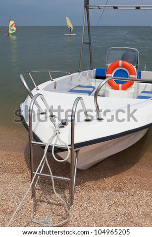 Moored boat with a lifeline near the surfing club - stock photo