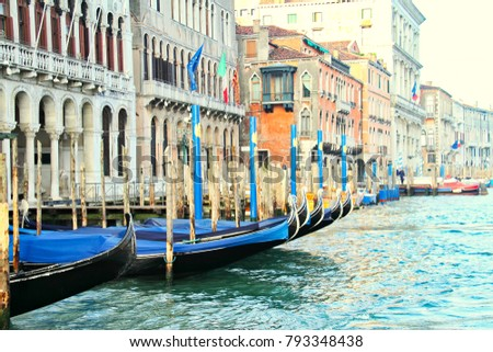 Moored gondolas in a row on the Grand Canal in Venice Italy. #793348438