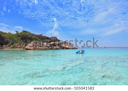 Moored in the bay inflatable boat. Exotic tropical Similan Islands. Clear azure ocean water