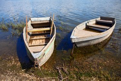 Moored old fishing wooden boats . Two vintage fishing boats in village