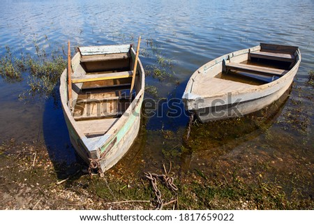 Moored old fishing wooden boats . Two vintage fishing boats in village Imagine de stoc ©
