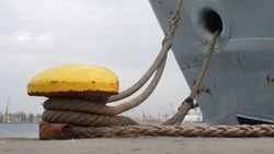 Moored Ship Swinging on Waves Moving Mooring Ropes Up and Down on Bollard