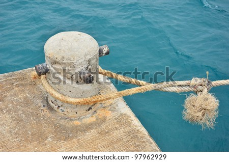 Mooring Bollard With Knotted Nautical Rope