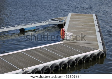 Mooring pontoon surrounded by calm water on a sunny day