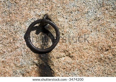 Mooring ring attached to a stone wall