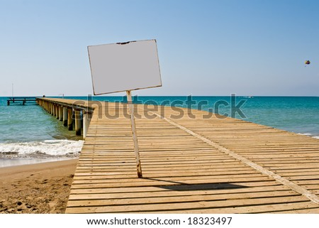 Mooring with an information board on a background of the blue sky