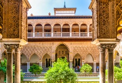 Moorish architecture of beautiful castle called Real Alcazar in Seville, Andalusia, Spain