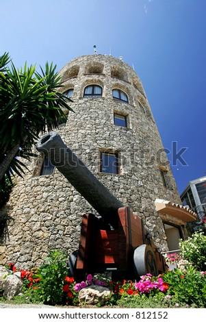 Moorish Tower and Cannon in Puerto Banus in the port of Puerto Banus in Spain
